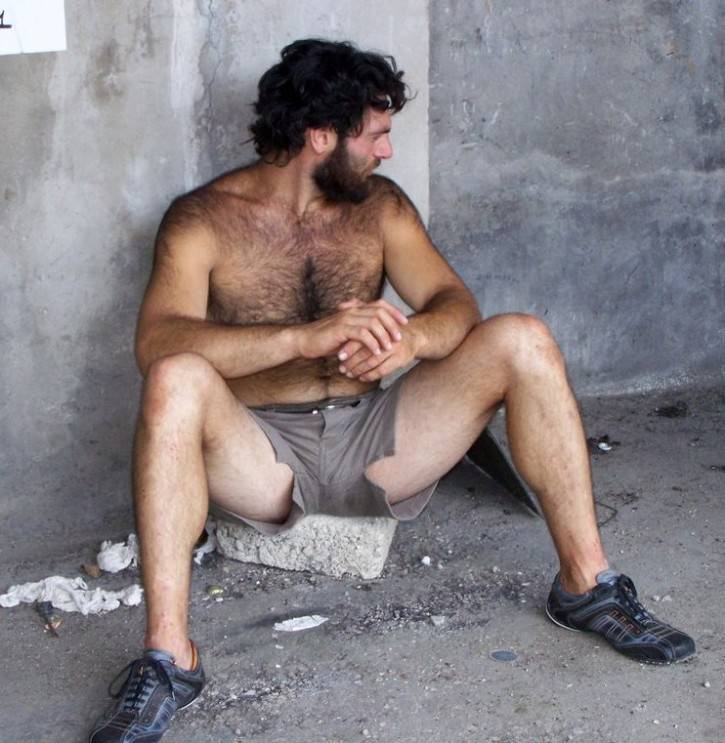 image Handsome hairy bearded latino smoking cigar with chaturbate viewers